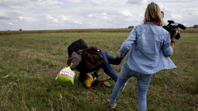 Hungarian Top Court Clears Camerawoman Who Kicked Migrants
