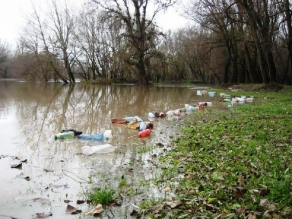 Floating Waste Flowing Down On River Tisza In Hungary