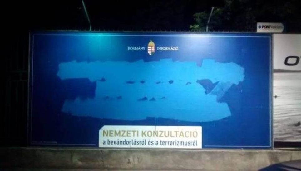 Hungarian Political Activists Deface Government Billboards